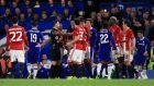 Several Manchester United players surrounded referee Michael Oliver, centre, after the sending-off of Ander Herrera