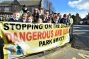 HATTON PRIMARY PUPILS AND COMMUNITY WARDENS BEHIND THE NEW ZIG ZAG BANNER