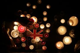 Members of the public light candles during the vigil in Trafalgar Square, London to remember those who lost their lives in the Westminster terrorist attack.