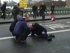 Screengrab from a video posted on the twitter feed of @sikorskiradek of people attending to a person on Westminster Bridge, London following the incident