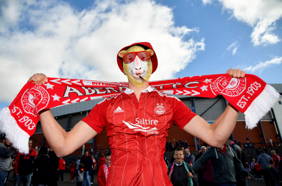 An Aberdeen supporter is pictured pre-match