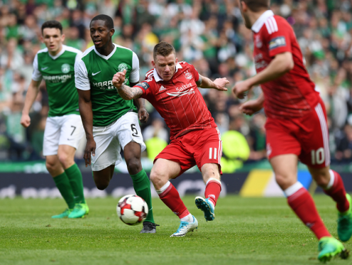 Jonny Hayes with a late effort that led to the goal