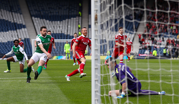 Adam Rooney scores just 12 seconds into the game   Andrew Milligan/PA Wire