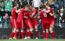 Rooney (centre) celebrates with his teammates   Andrew Milligan/PA Wire