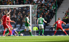 Hibs goalkeeper Ofir Marciano cannot prevent Ryan Christie's cross from crossing the line