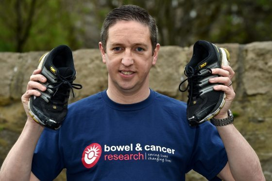 Andy Farquhar is running the London Marathon for a bowel cancer charity in memory of his mum Elizabeth and gran Betty, who both died from the illness. Picture by Kenny Elrick.