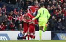Aberdeen players celebrate Hibernian's Darren McGregor scoring an own goal