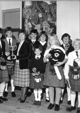 Drumming competition winner Susan Low presented with her trophy at Carrbridge Ceilidh Week, 1983