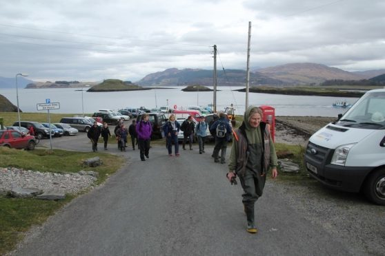 Eva Tombs  leads the way to show the best places to forage for seaweed on Lismore.