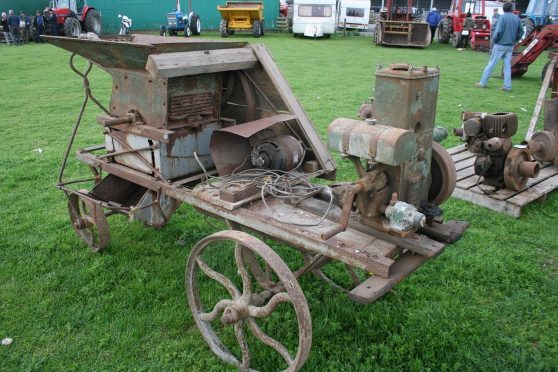 A Lister D engine used to drive this vintage turnip cutter. These engines often turn up at farm sales for collectors to buy and restore.