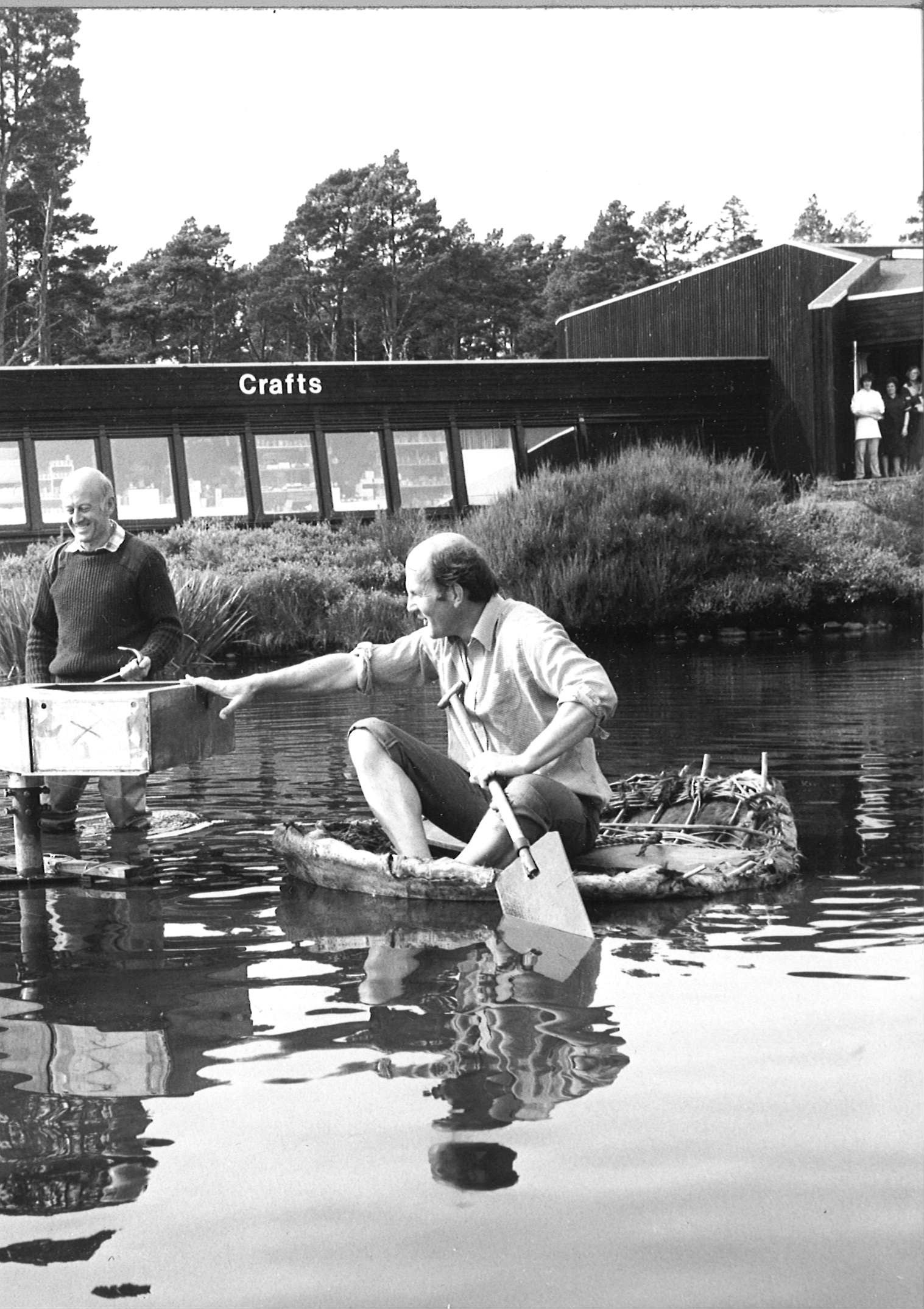 New sculpture in pond at Landmark. 1983. In the picture are Landmark owner David Hayes and handyman Granville Brown