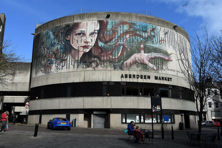 Herakut (DU), on Aberdeen Market, Market Street.