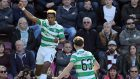 Scott Sinclair, left, netted a hat-trick as Celtic secured the title