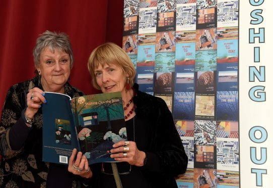 In the picture are from left: Dolleen Maclennan, left and Hilda Frewin with the front cover.