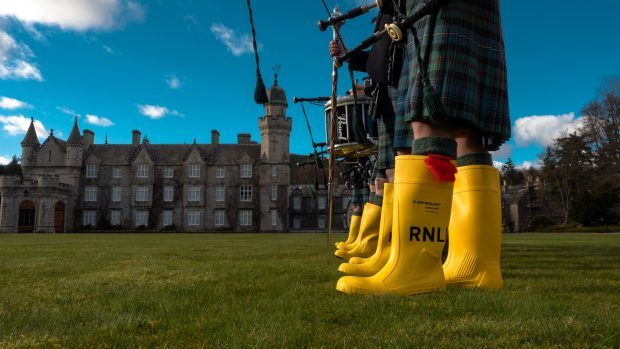 Traditional pipe band footwear is replaced to support the RNLI's mayday campaign