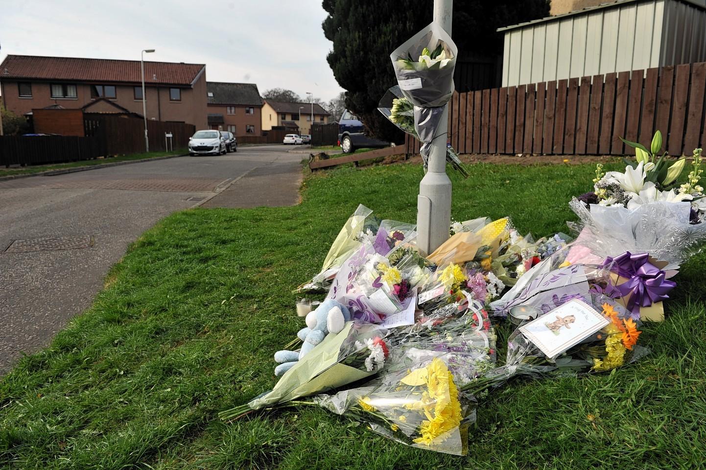 Tributes left to Kieran at the scene in Elgin