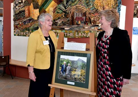 The Bennachie Visitor Centre opens for the season. Pictured with a photograph of Algy Watson and James Mackay is Mary MacKay (left) whose late husband James was one of the driving forces of the centre and chair Sheena Lonchay (right)