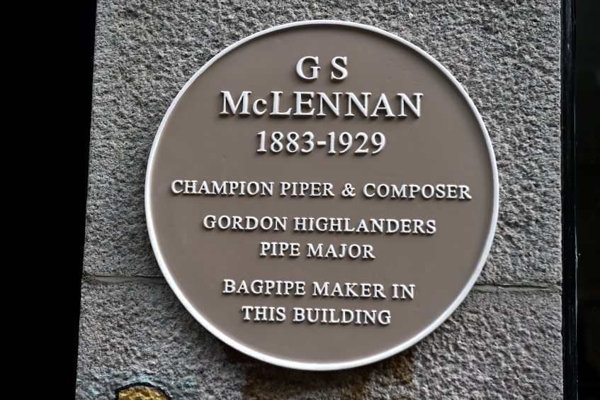 The plaque in the memory of the famous Piper George Stewart Mclennan (G.S. McLennan) on Bath Street, Abereen.