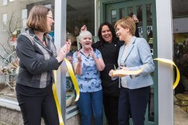 Eilidh Whiteford and Nicola Sturgeon help mother and daughter pair Kathleen Schuitema and Lindsay Palmer open their shop.