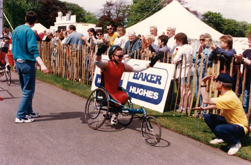 Wheelchair event winner Kenny Suttie comes home in delight in 1997