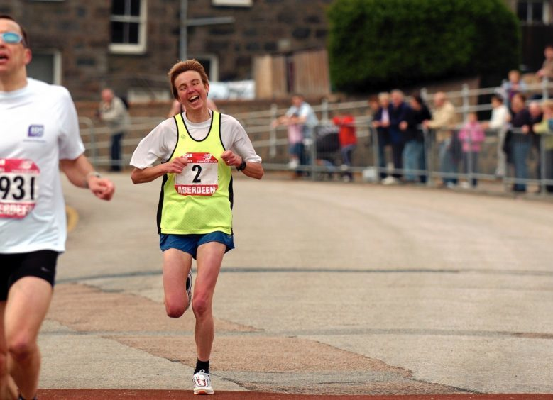 Jane Barker crosses the finishing line for first place in the ladies race in 2005.