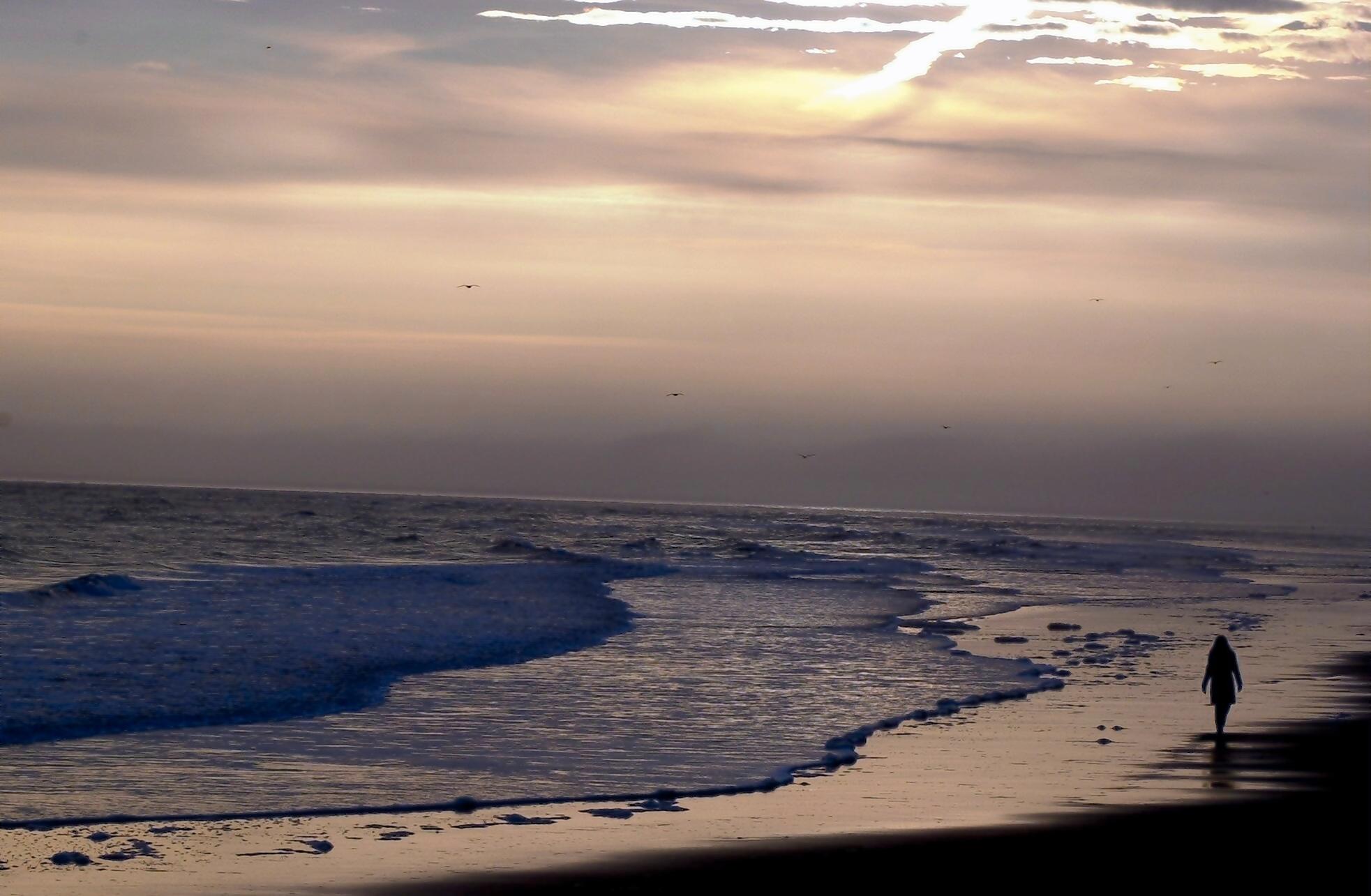 SCOTTISH LIFE - AN EARLY MORNING STROLL ON DORNOCH BEACH. PIC COLIN RENNIE.