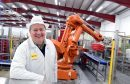 Robert Chapman of Farmlay Eggs and the new robots in his production plant.       Pictures and video by Kami Thomson.
