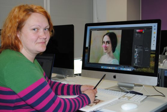 Evija Laivina at Inverness College UHI with an image from her award-winning 'Beauty Warriors' series