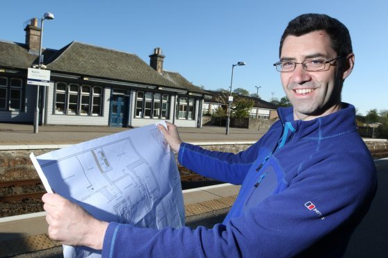 Matthew Hilton at the possible site of the new Men's Shed in Nairn, in the old Seedhouse florist's building at the train station.