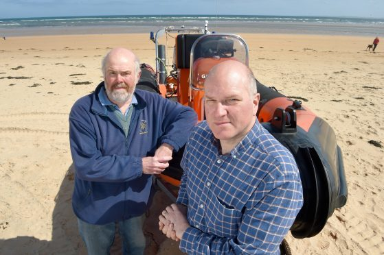 Photographed with their lifeboat on Dornoch Beach are Neil Dalton (left) Chairman of the Association and on the right Antony Hope, a crew member. Pic by Sandy McCook