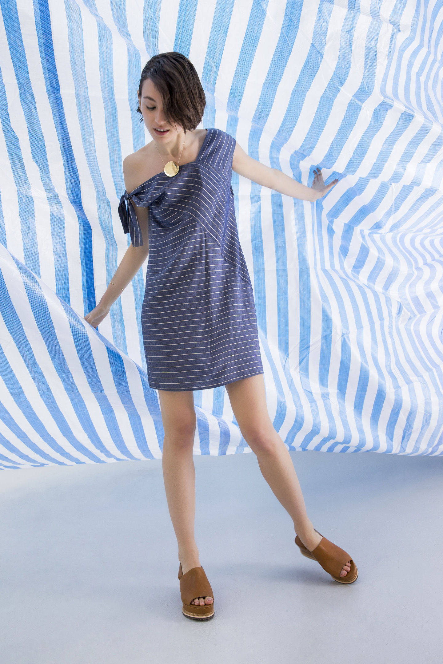 Undated Handout Photo of a model wearing the Oliver Bonas Absorb Asymmetric Stripe Dress, available from oliverbonas.com. See PA Feature FASHION Stripes. Picture credit should read: PA Photo/Handout. WARNING: This picture must only be used to accompany PA Feature FASHION Stripes. WARNING: This picture must only be used with the full product information as stated above.