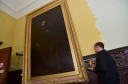 John Barclay of firm Corporate Moves begins removing a portrait of Sir Alexander Baillie from the Town House.