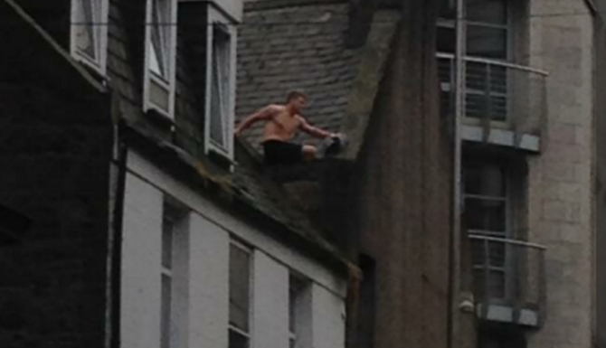 The man has been on top of the roof in Aberdeen city centre for hours