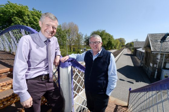 Leader of the Scottish Liberal Democrats, Willie Rennie (left) with Jamie Stone at Tain Railway Station