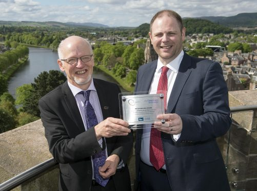 L-R Graeme Ambrose, chief executive of VisitInvernessLochNess receives award from David Allen, director of Scotland for People    see press release  contact Julie Edgar, PR, 0789 987 5151 or julie@jecommunications.co.uk