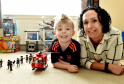 Alex Crichton, 7, suffered a stroke when he was a baby which resulted in brain complications. He is pictured with his mum Julie. He has recently had support from Child Brain Injury Trust.