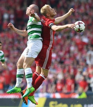 Celtic's Scott Brown (left) and Aberdeen's Jayden Stockley compete for the ball