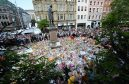 Tributes to those killed and injured laid in St Ann's Square, Manchester