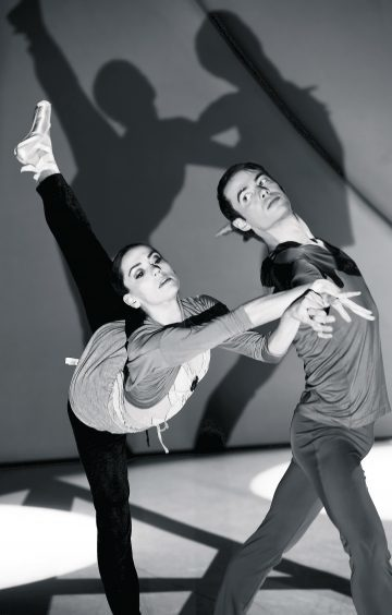 Principle dancers Sophie Martin and Christopher Harrison warming up for the show on the stage at HMT.