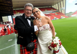 Die hard Dons fans honour club with wedding at Pittodre