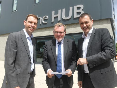 Scottish Secretary Davd Mundell, centre, visited The Hub in Aberdeen on Friday as apart of a Trip to the north-east.  Pictured with him are James Bream, the director of policy at Aberdeen Chamber of Commerce and Russell Borthwick the chief executive of the Chamber of Commerce.