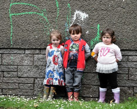 In the picture are pupils from left: Poppy Ramsay, 4, Liam Wallace, 5, and Kayla Carnegie, 4.  Picture by Jim Irvine