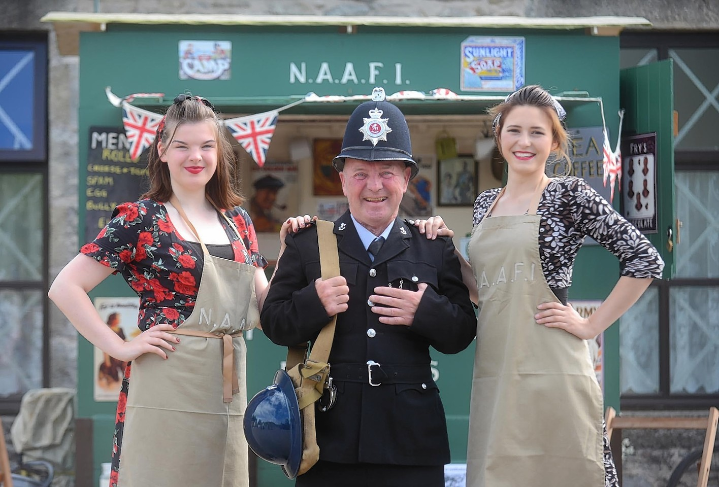 In photo from the left Roy Killen, Georgia Cassidy 19 (left) and  Ellie Inch 19 (right) NAAFI