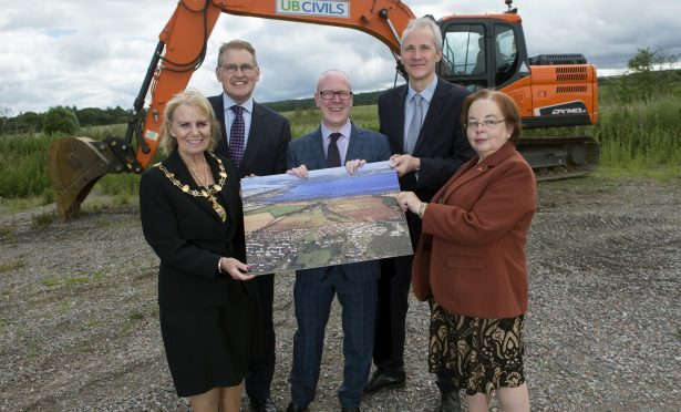 Helen Carmichael, Provost of Inverness , Brian Clarke , Hazledene Inverness Housing Minister Kevin Stewart MSP Stuart Black Director of Development & infrastructure highland council and Trish Robertson, vice chair of places committee Highland council  at Stratton Site in Inverness  PIC   Trevor Martin