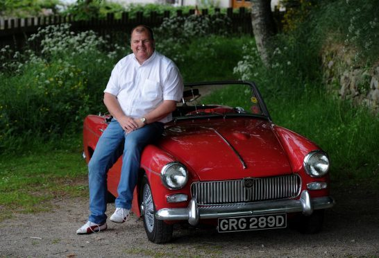 Dave Gordon with his 1965 MG Midget Mk2.  Pictures by Jim Irvine