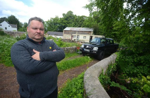 "Elgin City South councillor Graham Leadbitter believes the mill has ""huge potential"" if the rubbish is cleared."