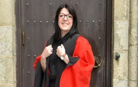 Kerry Karam, who graduated with a PhD in English Language and Linguistics outside Elphinstone Hall.