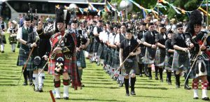 The mass pipes and drums led by Drum Major Bert Summers (Pictures and video: Colin Rennie)