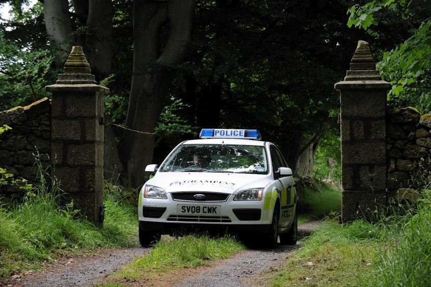 Police at the entrance to Sandy Ingram's home in 2010