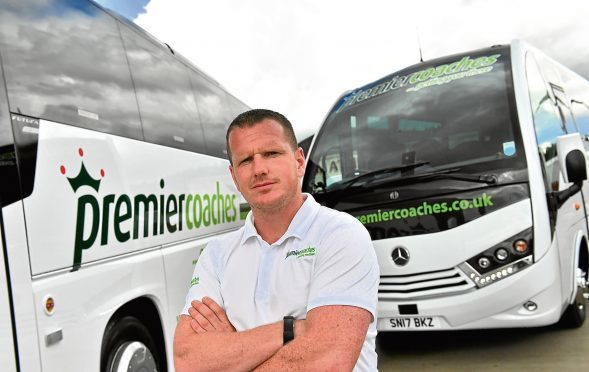 BUSINESS ;  Premier Coaches have invested £1million on six new vehicles over the past six months.      Pictured - Managing Director Alan Findlater with two of his new coaches.       Picture by Kami Thomson    31-07-17